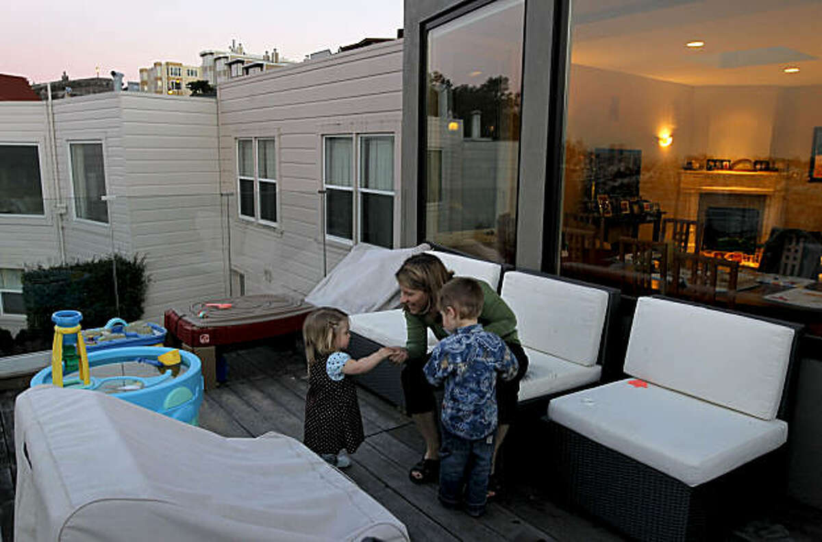 Kristin Hansen on Wednesday Feb. 2, 2011, in her Noe Valley home, in San Francisco, Ca., with her children Anika, 1-year-old and Dane, 3-years-old, on the backyard deck which is part of the new construction. Discretionary review allows neighbors to protest additions, remodels, and improvements on their own and hold them up. Hansen's project for additions ended up taking a full year in reviews and costing $150,000.