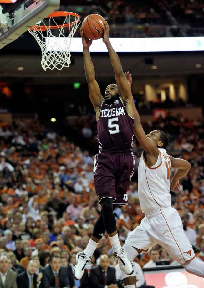 Texas A&M guard Dash Harris (5) goes to the basket against Texas forward Jonathan Holmes during the first half of an NCAA college basketball game Wednesday, Jan. 11, 2012, in Austin, Texas. (AP Photo/Michael Thomas) Photo: Michael Thomas, Associated Press / FR65778 AP