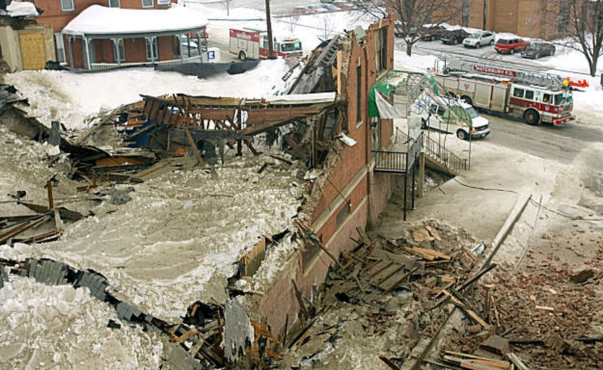 The old Sena Lanes building on North Main Street in Waterbury, Conn. is seen after it collapsed under the weight of snow and ice Wednesday, Feb. 2, 2011.