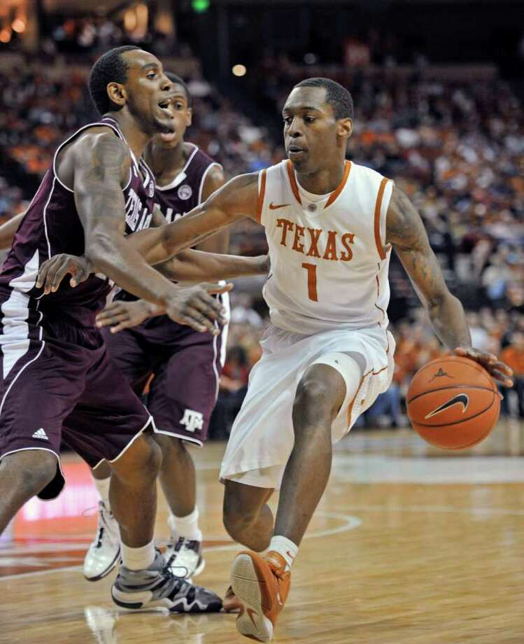 Texas guard Sheldon McClellan, right, drives the ball against Texas A&M forward David Loubeau, left, during the first half of an NCAA college basketball game Wednesday, Jan. 11, 2012, in Austin, Texas. (AP Photo/Michael Thomas) Photo: Michael Thomas, Associated Press / FR65778 AP