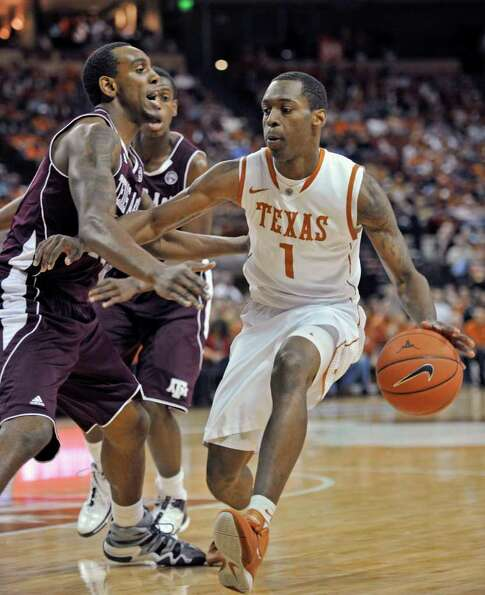 Texas guard Sheldon McClellan, right, drives the ball against Texas A&M forward David Loubeau, left,