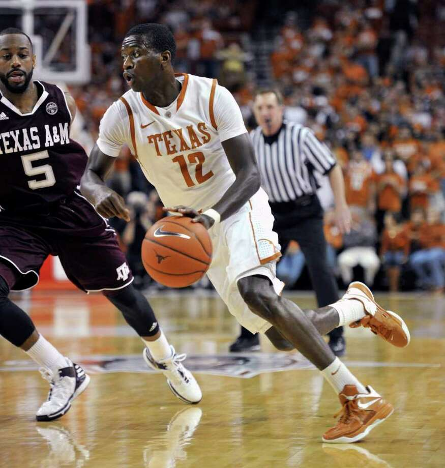 Texas guard Myck Kabongo (12) drives around Texas A&M guard Dash Harris (5) during the first half of an NCAA college basketball game Wednesday, Jan. 11, 2012, in Austin, Texas. (AP Photo/Michael Thomas) Photo: Michael Thomas, Associated Press / FR65778 AP