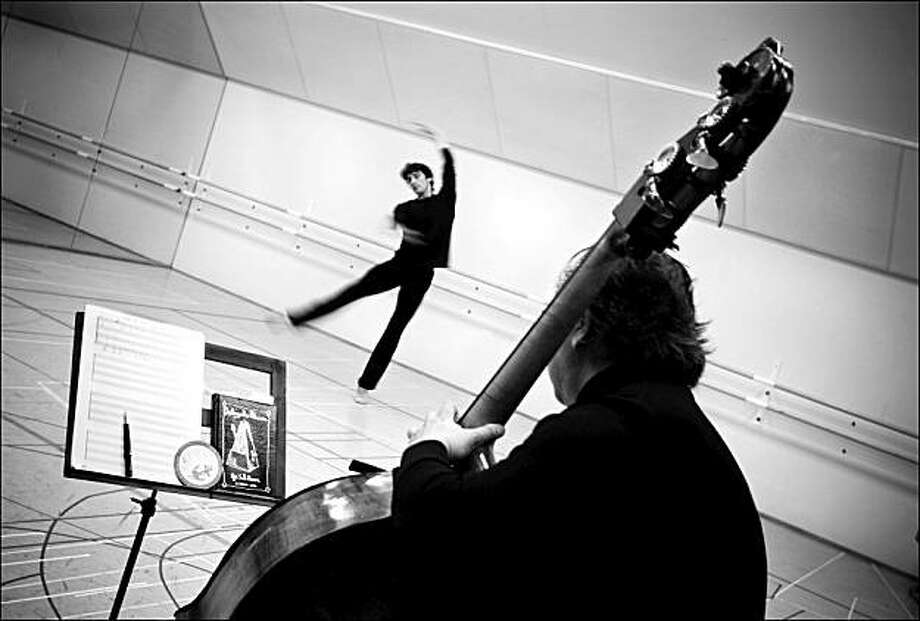 "SF Ballet principal Pierre-Francois Vilanoba rehearses Yuri Possokhov's new ""Raku"" with the score's composer, bassist Shinji Eshima, in the foreground Photo: Mark Whitely, SF Ballet"