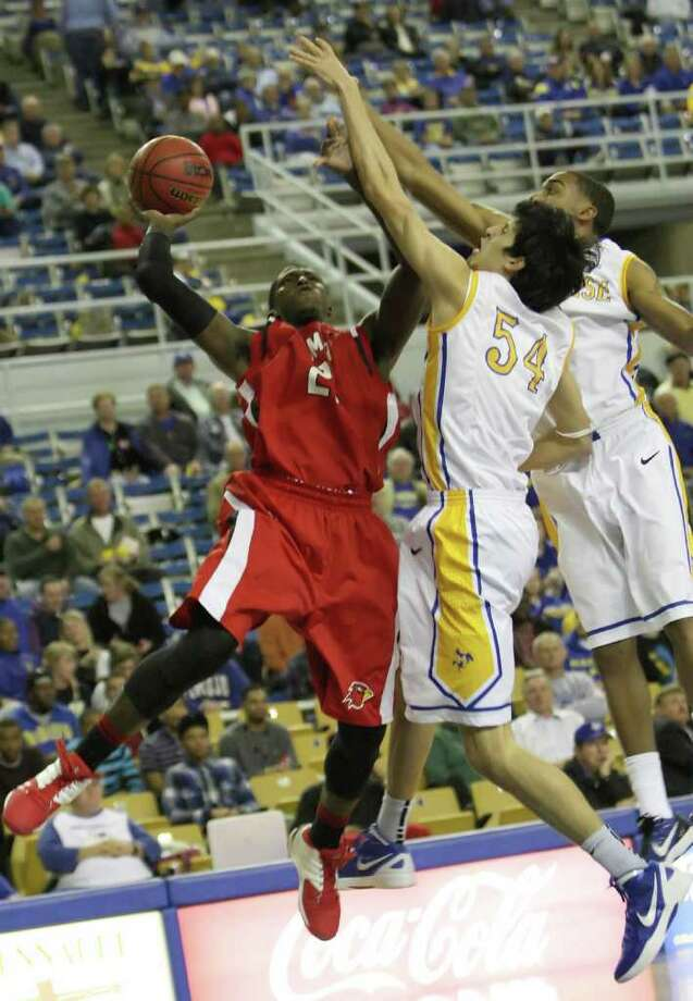 Charlie Harper, left, is fouled after a rebound during the game against McNeese State Wednesday in the Burton Coliseum in Lake Charles, LA. Photo: For The Enterprise / Matt Billiot