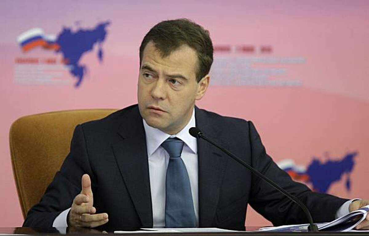 Russian President Dmitry Medvedev speaks during his meeting with local officials in Far East city of Khabarovsk, Russia, Friday, July 2, 2010. Medvedev said that he had signed the law to give a 50-percent discount on utilities payments for members of disabled war veterans' families. The president said this during the meeting with the Khabarovsk Territory's Governor Vyacheslav Shport on Friday.