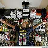 In his apartment, Patrick Christopher, basketball player for U.C. Berkeley, shows off his collection of more than 70 Nike sneakers on Wednesday, Feb. 20, 2008 in Berkeley, Calif.