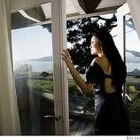 Anyi Lu, shoe designer, in the Master Bedroom with beam ceilings and window doors leading to small deck with views of The Bay. The home is in Tiburon which she shares with  her husband David Spatz and their daughter Yen Yen, 3, photographed on Tuesday, August 12, 2008.