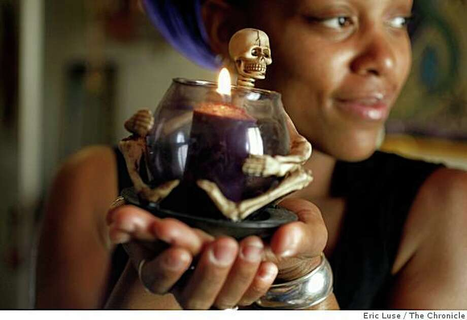 From her Altar, Gede which represents  Life & Death & Rebirth for Portsha Jefferson who  celebrates the Haitian All Hallows Eve and honors the Lord of the Dead in her Oakland home photographed on Monday, October 20, 2008.  Ran on: 10-29-2008Portsha Jefferson, an Oakland dance instructor who hosts a party to celebrate Ghede, Haiti's Day of the Dead, holds an ornament that will be part of her altar.Ran on: 10-29-2008Portsha Jefferson, an Oakland dance instructor who hosts a party to celebrate Ghede, Haiti's Day of the Dead, holds an ornament that will be part of her altar.Ran on: 10-29-2008Portsha Jefferson, an Oakland dance instructor who hosts a party to celebrate Ghede, Haiti's Day of the Dead, holds an ornament that will be part of her altar.Ran on: 10-29-2008Portsha Jefferson, an Oakland dance instructor who hosts a party to celebrate Ghede, Haiti's Day of the Dead, holds an ornament that will be part of her altar. Photo: Eric Luse, The Chronicle