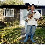Pauline Hickman who lost her husband Charles W. Hickman to cancer at the age of 73 in 2002 poses for a portrait outside an outbuilding on her Beachwood property with her grandson Donte Allen age 11 that now wears his grandfathers boots as he takes care of his pet chickens in Merced Calif Wednesday Dec 10, 2008.