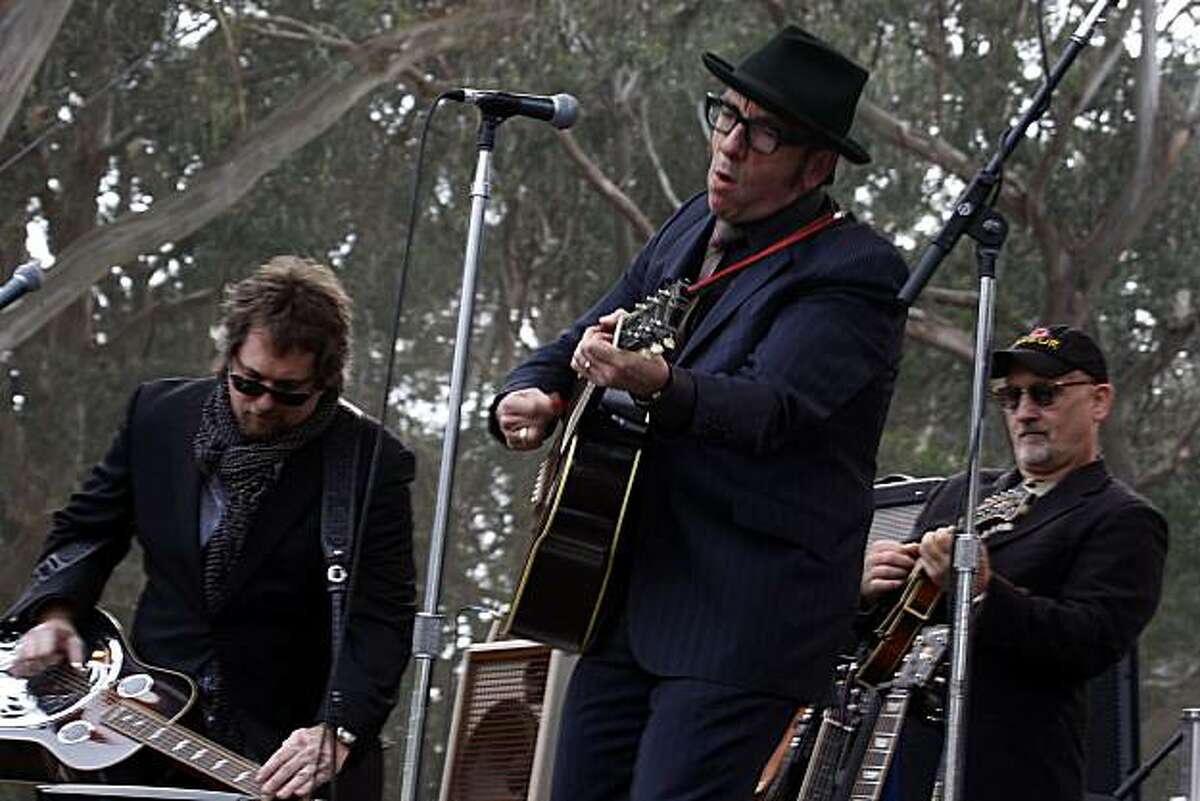 Elvis Costello at the 10th annual Hardly Strictly Bluegrass Festival in San Francisco's Golden Gate Park on Sunday. At left is Jerry Douglas, and at right is Mike Compton.