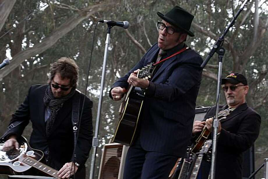 Elvis Costello at the 10th annual Hardly Strictly Bluegrass Festival in San Francisco's Golden Gate Park on Sunday. At left is Jerry Douglas, and at right is Mike Compton. Photo: Liz Hafalia, The Chronicle