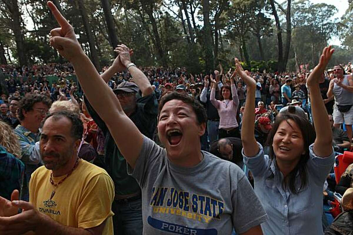 Jennifer Kim (left) and Janell Hampton (right) of Oakland jam to Indigo Girls at the 10th annual Hardly Strictly Bluegrass Festival in San Francisco's Golden Gate Park on Sunday.