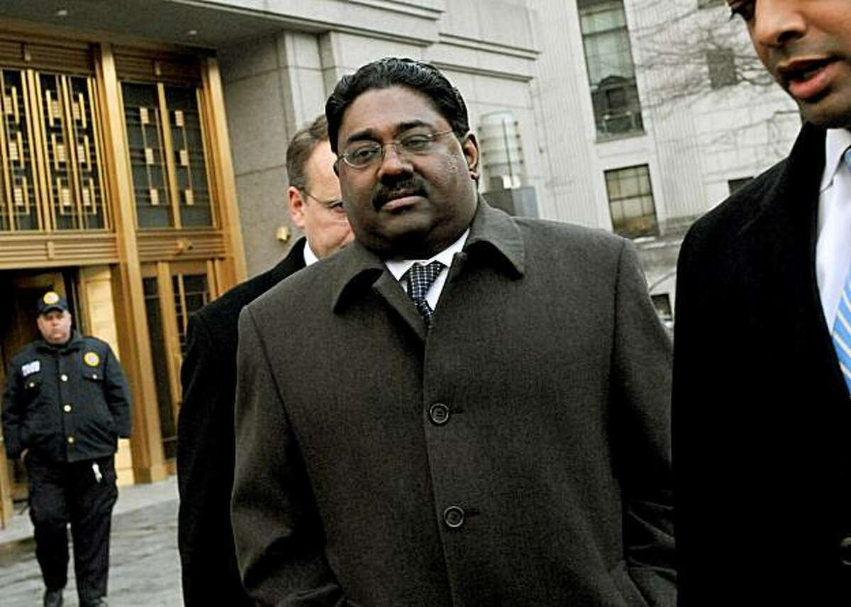 FILE - In this file photo taken Feb. 17, 2010, Raj Rajaratnam, left, billionaire founder of the Galleon Group, a major hedge fund, leaves Manhattan federal court in New York.
