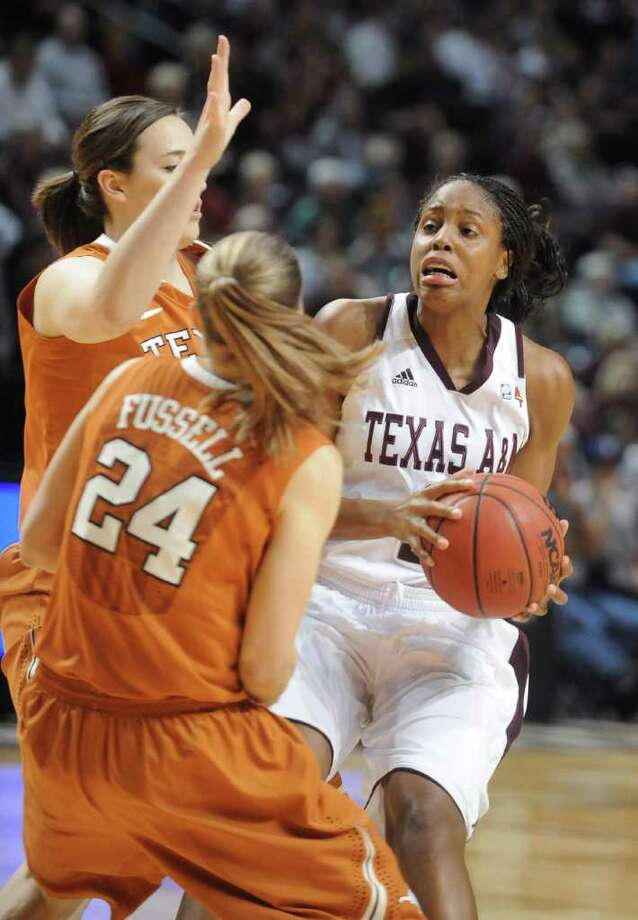Texas A&M's Adaora Elonu is pressured by Texas defenders Anne Marie Hartung, rear, and Chassidy Fussell during the first half of an NCAA college basketball game Wednesday, Jan. 11, 2012, in College Station, Texas. (AP Photo/Bryan-College Station Eagle, Dave McDermand) Photo: Dave McDermand, Associated Press / Bryan-College Station Eagle