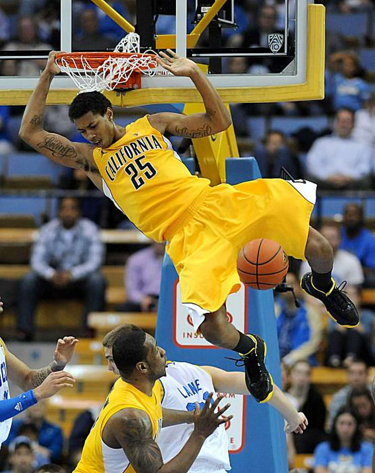 California's Richard Solomon (25) dunks during the second half of the NCAA basketball game against UCLA Thursday, Jan. 20, 2011, in Los Angeles.