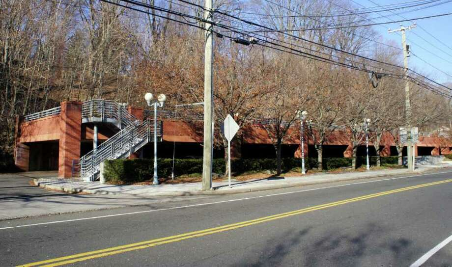 Greenfield Partners, a Norwalk-based commercial real estate firm, is seeking to add a third level to this parking deck that it owns on Wilton Road on the west side of downtown Westport. Photo: Paul Schott / Westport News