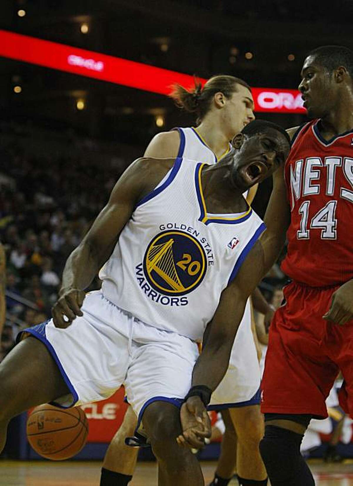 Warriors #20 Ekpe Udoh makes a face after a slam dunk at Oracle Arena during the first half of a home game with Golden State Warriors and the New Jersey Nets on Monday January. 17, 2011 in Oakland, Calif.