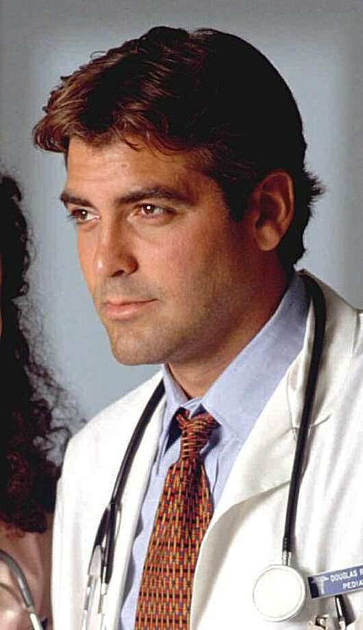 "NBC101 10/04/94 -- 'ER' -- Generic  -- TELECAST DATES: Thursdays (10-11 p.m. ET) --  PICTURED:  Julianna Margulies,  George Clooney -- JULIANNA MARGULIES, GEORGE CLOONEYANTHONY  STAR IN 'ER' -- Nurse Carol Hathaway (Julianna Margulies) and Dr. Ross (George Clooney) are two former lovers who cannot seem to stay away from each other while working in a large Chicago teaching hospital, in NBC's new medical series ""ER"", created by best-selling author Michael Crichton (""Jurassic Park,"" ""Rising Sun"") -- PHOTOBY:  Chris Haston. Photo: Chris Haston"