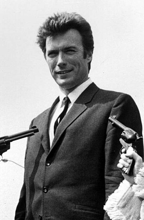 1st June 1967:  American actor Clint Eastwood finds himself at the mercy of three gun-toting gals upon his arrival at London Airport to promote his latest film. From left to right, the bare-legged banditos are Sandra Marshall, Anita McGregor and Susan Melody.  (Photo by Central Press/Getty Images) Photo: Central Press