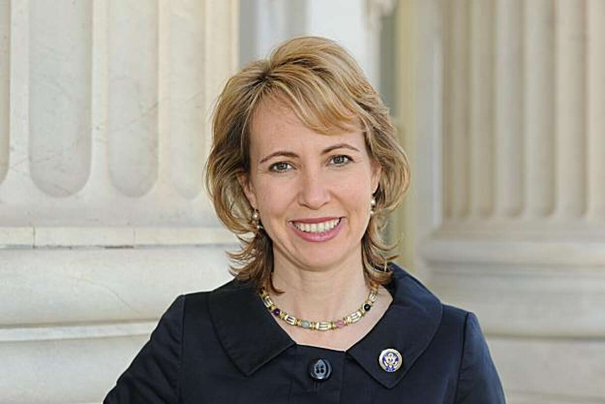 FILE - In this March, 2010 file photo provided by the office of Rep. Gabrielle Giffords, D-Ariz., Giffords poses for a photo. The husband of Rep. Giffords says his wife's condition has improved so much that she has been able to smile and give him a neck rub as he has kept a near-constant vigil at her hospital bedside. The interactions with astronaut Mark Kelly are new signs of Giffords' impressive progress in recovering from a gunshot wound to the head at a political event nine days ago. Giffords still cannot speak, because of a tube in her throat that is helping her breathe.