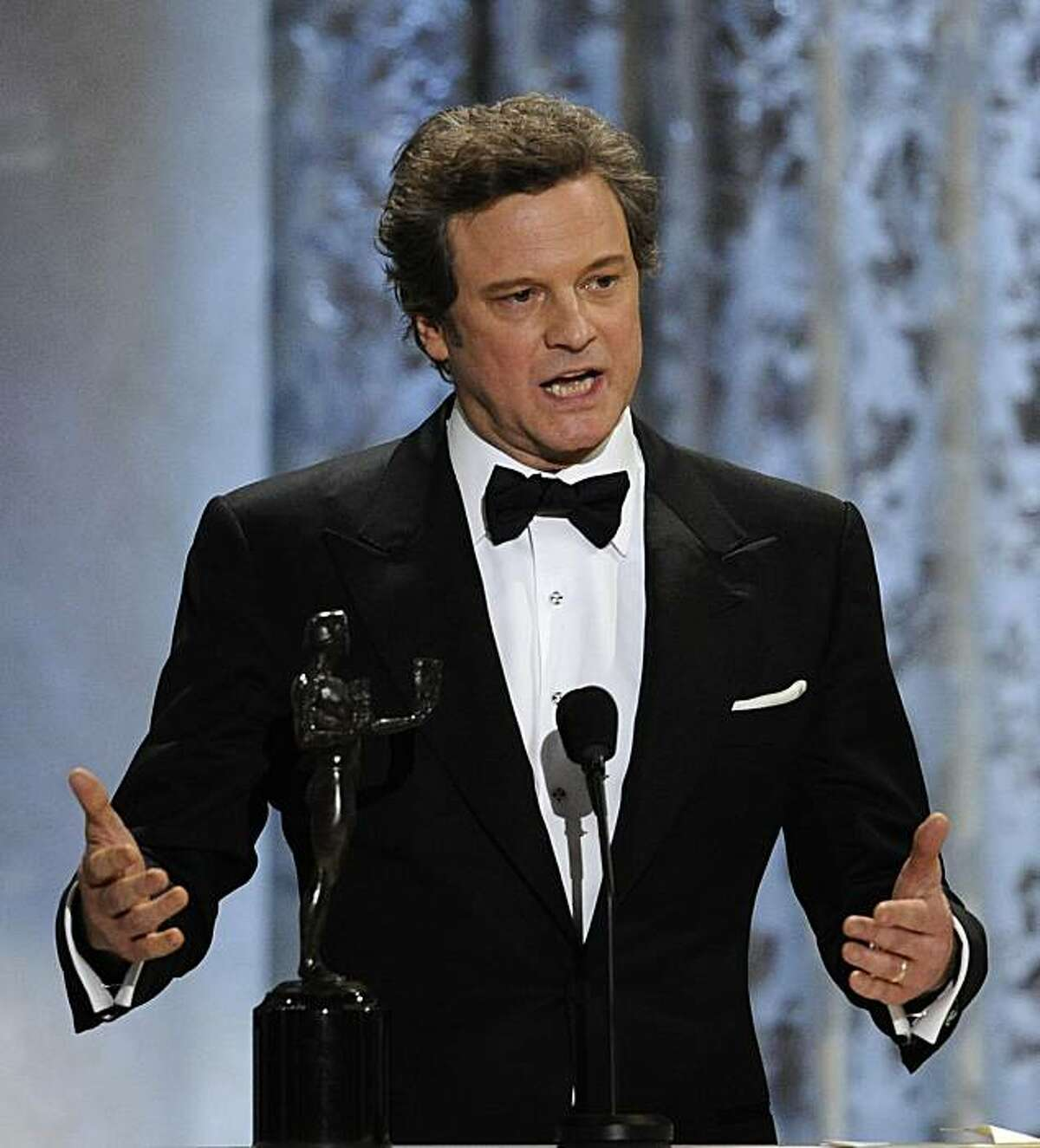 Colin Firth accepts the award for best male actor in a leading role for