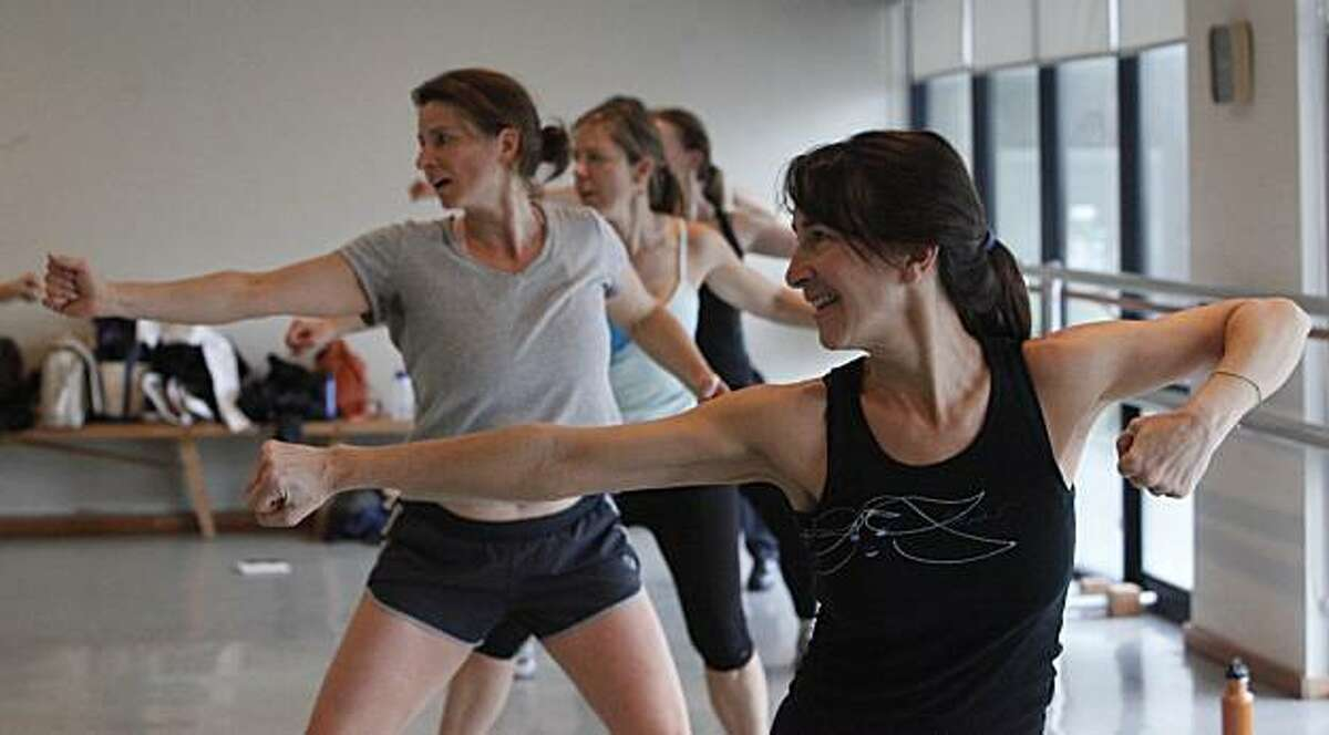 Tamra Sattler (foreground) of Sausalito shouts out affirmations during an Intensati class led by instructor Eileen McCarthy (not shown) at Roco Dance and Fitness on Friday, January 7, 2011 in Mill Valley, Calif.