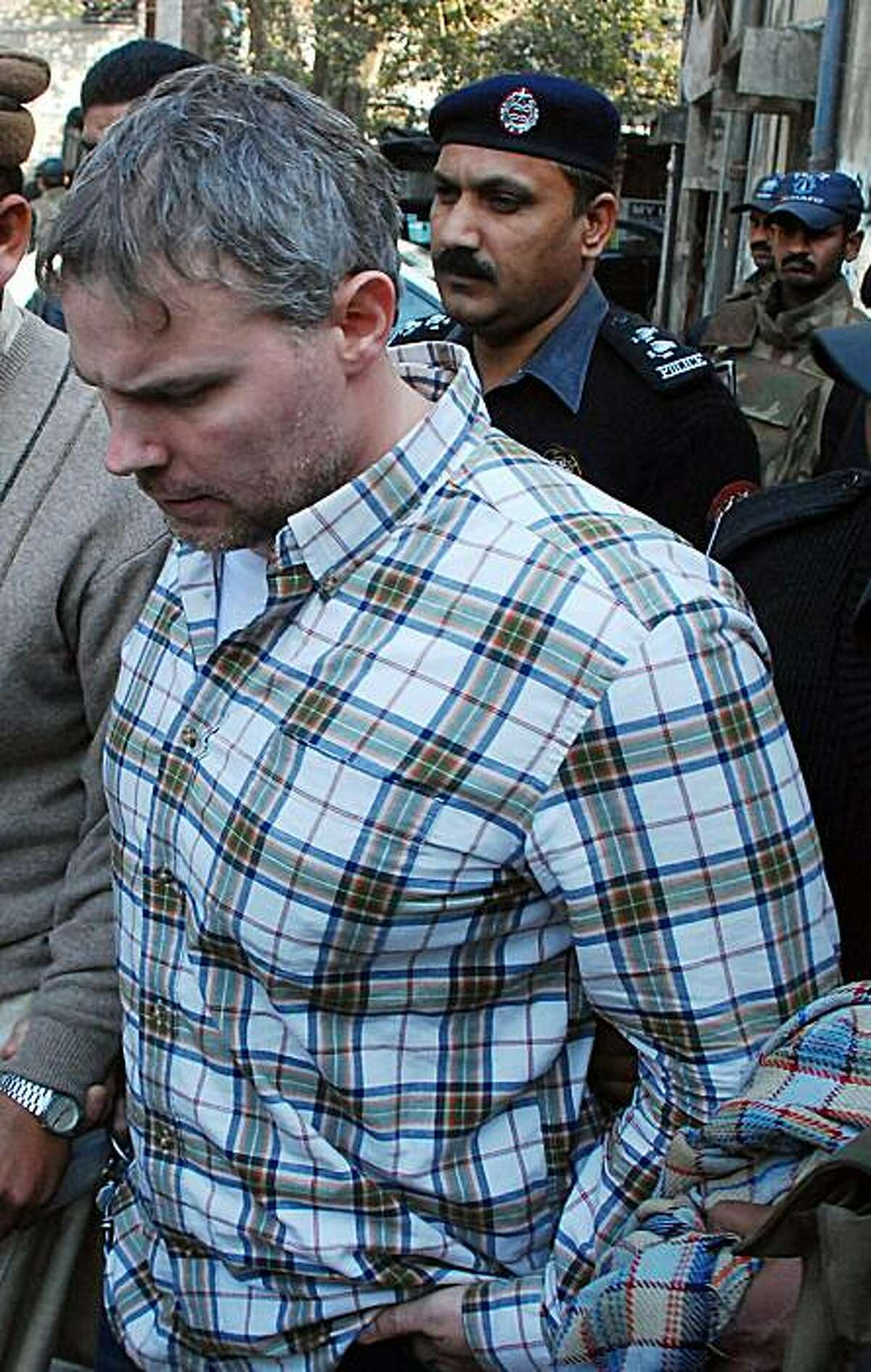 Pakistani police escorts arrested US national Raymond Davis to a court in Lahore on January 28, 2011. An American man was being held at a Pakistan police station on double murder charges, police said, a day after he shot dead two men on a motorcycle in what he said was self-defence.