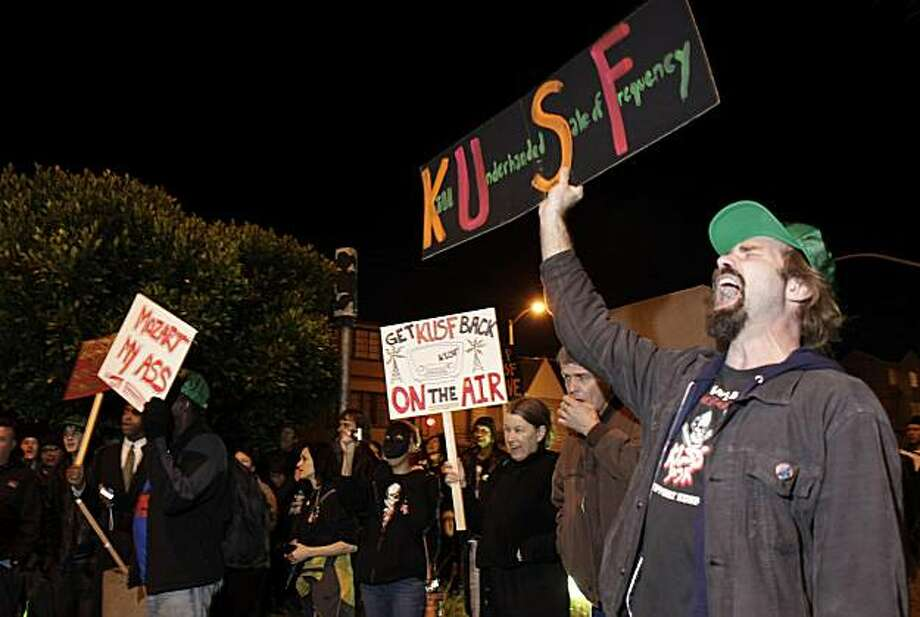 Jay Jaworski, right, a volunteer at KUSF, yells his displeasure at the University's decision to end the radio station's broadcasting at a protest Wednesday evening. Students, deejays and members of the community came to the University of San Francisco's Presentation Theater in San Francisco, Calif., on Wedensday, January 19, 2011, to protest the demise of KUSF. Photo: Carlos Avila Gonzalez, The Chronicle