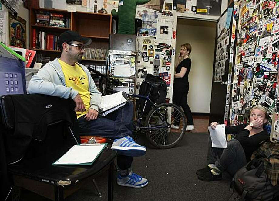KUSF volunteers Ethan Jenkins and Claudia Mueller and paid employee Miranda Morris are in disbelief after their popular public radio station on the University of San Francisco's campus was abruptly shut down Tuesday. Photo: Lance Iversen, The Chronicle