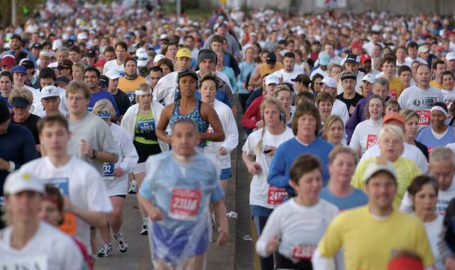 01/18/2004--Start of the 2003 Houston Marathon, Sunday morning, as runners cross the Elysian Viaduct.  Photo by Steve Ueckert / Chronicle Photo: Steve Ueckert / Houston Chronicle