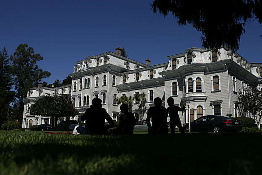 (Left to right) Octavia Sisley, Kelly Brown, Kevin Brown and Ian Brown are silhouetted against Mills Hall while enjoying the open grass in front at the Oval at the Mills College campus in Oakland, Calif., on Friday, Sept. 24, 2010. Photo: Kirsten Aguilar, The Chronicle