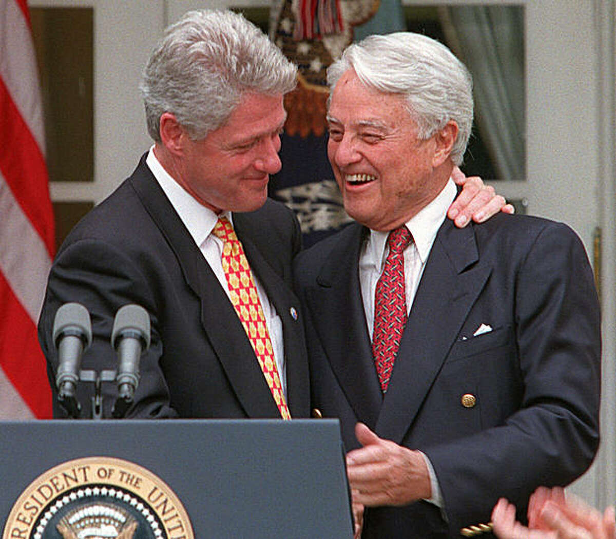 FILE - In this June 19, 1996 file photo, President Clinton embraces R. Sargent Shriver in the Rose Garden of the White House Wednesday June 19, 1996 during a ceremony to honor the 35th anniversary of the Peace Corps. Shriver was named the first director of the Peace Corps by President John F. Kennedy. Shriver, the exuberant public servant and Kennedy in-law whose singular career included directing the Peace Corps, fighting the