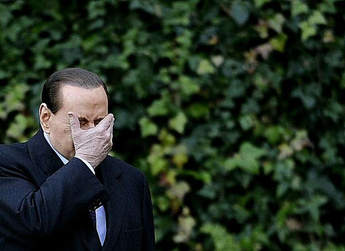 Italian Prime Minister Silvio Berlusconi holds his face in his hand at the Villa Madama in Rome as he arrives for a meeting with Slovenia's President Danilo Turk on January 18, 2011. Allegations that Prime Minister Silvio Berlusconi hooked up with prostitutes he kept in rent-free luxury apartments have weakened the government and damaged the country's image abroad, experts say. Italian magistrates last week announced an enquiry into the relationship between Berlusconi and an underage girl, known as Ruby,as the prime minister was still reeling from a court ruling partially stripping him of political immunity.