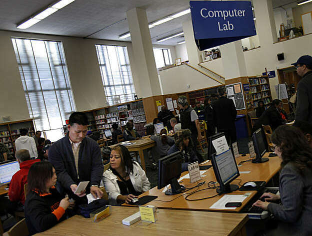 The computer lab area of the library was turned into the application area. Dozens of people stood in line at the Oakland Public Library on 14th Street Tuesday January 25, 2011 for the chance to get Section 8 housing in the future. Photo: Brant Ward, The Chronicle