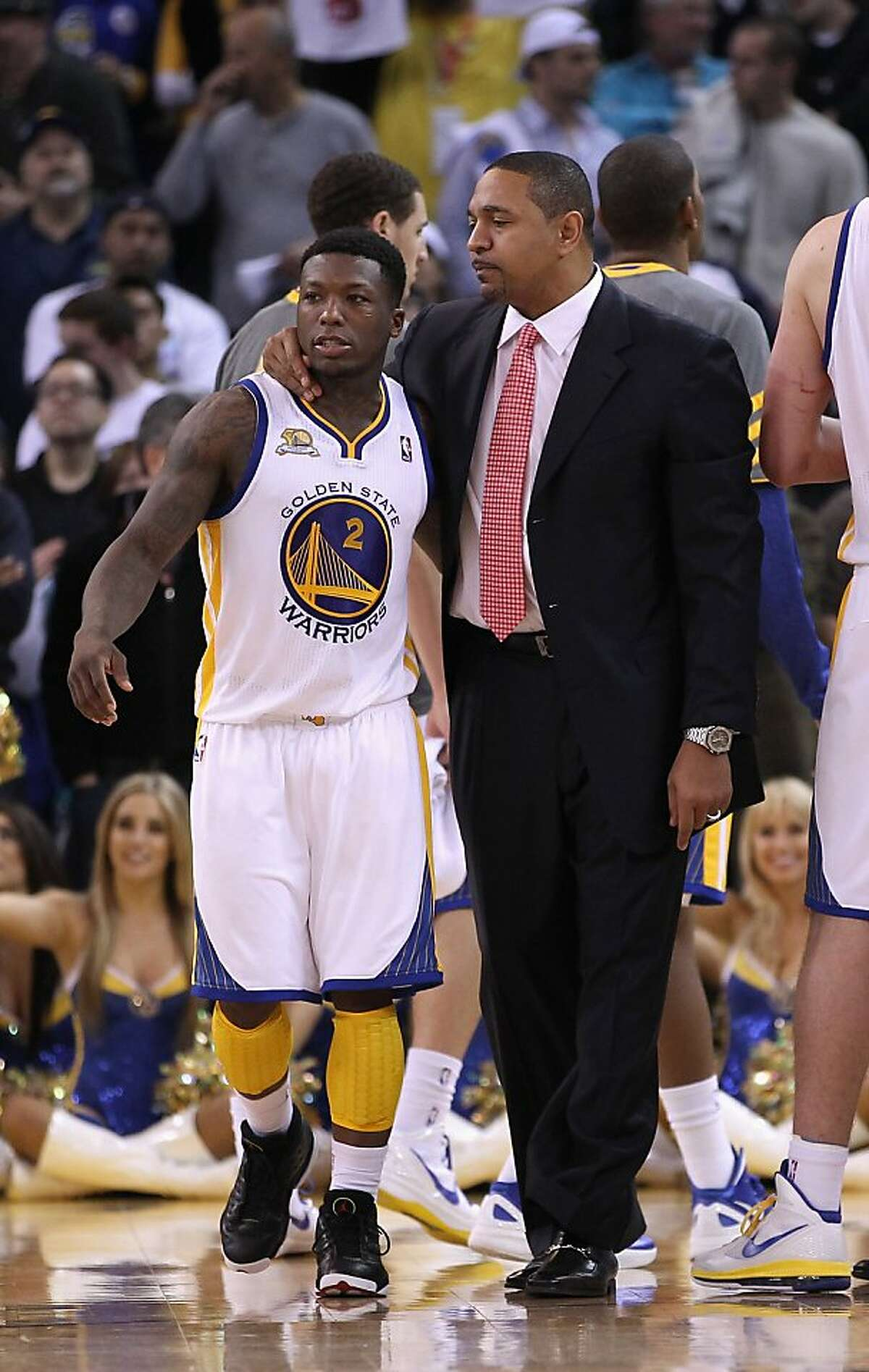 OAKLAND, CA - JANUARY 10: Head coach Mark Jackson of the Golden State Warriors talks to Nate Robinson #2 of the Golden State Warriors during their game against the Miami Heat at Oracle Arena on January 10, 2012 in Oakland, California. NOTE TO USER: User expressly acknowledges and agrees that, by downloading and or using this photograph, User is consenting to the terms and conditions of the Getty Images License Agreement. (Photo by Ezra Shaw/Getty Images)