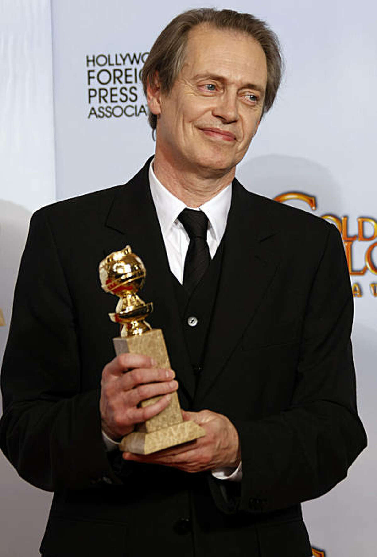 Steve Buscemi with his award at the 68th Annual Golden Globe Awards on Sunday, January 16, 2011, at the Beverly Hilton Hotel in Beverly Hills, California. (Brian van der Brug/Los Angeles Times/MCT)