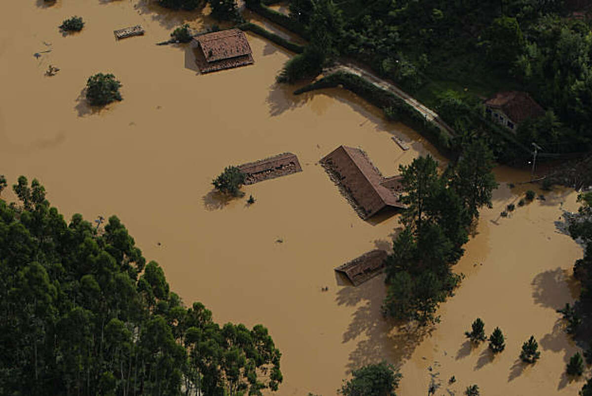 A flooded area is seen in Nova Friburgo, Brazil, Monday, Jan. 17, 2011. Brazil's army on Monday sent 700 soldiers to help throw a lifeline to desperate neighborhoods that have been cut off from food, water or help in recovering bodies since mudslides killed at least 655 people.