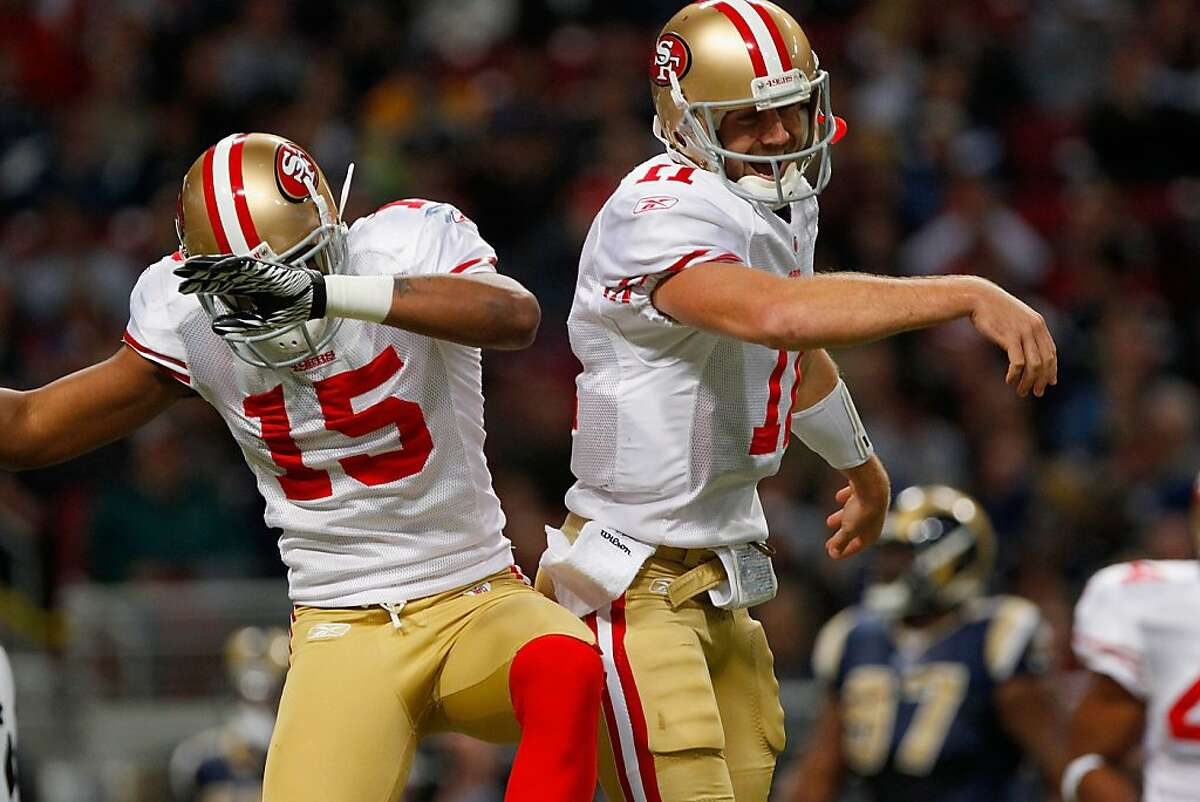 ST. LOUIS, MO - JANUARY 1: Wide receiver Michael Crabtree #15 and quarterback Alex Smith #11 of the San Francisco 49ers celebrate Crabtree's touchdown in the first half of the game on January 1, 2012 at the Edward Jones Dome in St. Louis, Missouri. The 49ers defeated the Rams 34-27. (Photo by Whitney Curtis/Getty Images)