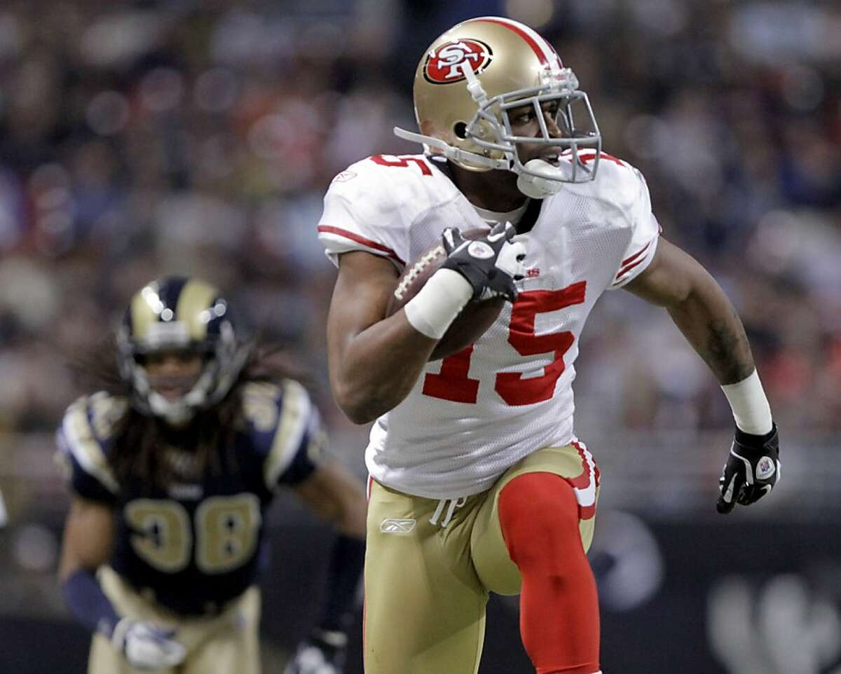 San Francisco 49ers wide receiver Michael Crabtree (15) runs ahead of St. Louis Rams defensive back Josh Gordy, left rear, after catching a pass and running it in 28-yards for a touchdown during the second quarter of an NFL football game Sunday, Jan. 1, 2012, in St. Louis. (AP Photo/Seth Perlman)