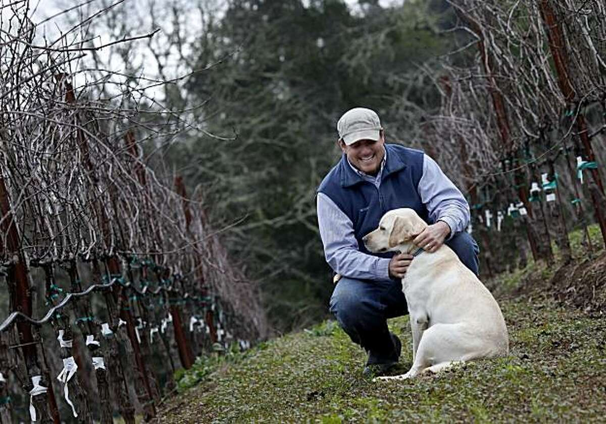 Matt Taylor pauses to praise his dog Zion who gets to go to work with him Tuesday January 11, 2011. Matt Taylor has been named one of the