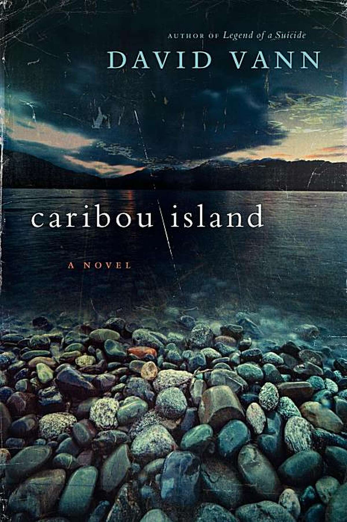 """In this book cover image released by Harper, """"Caribou Island"""" by David Vann is shown."""