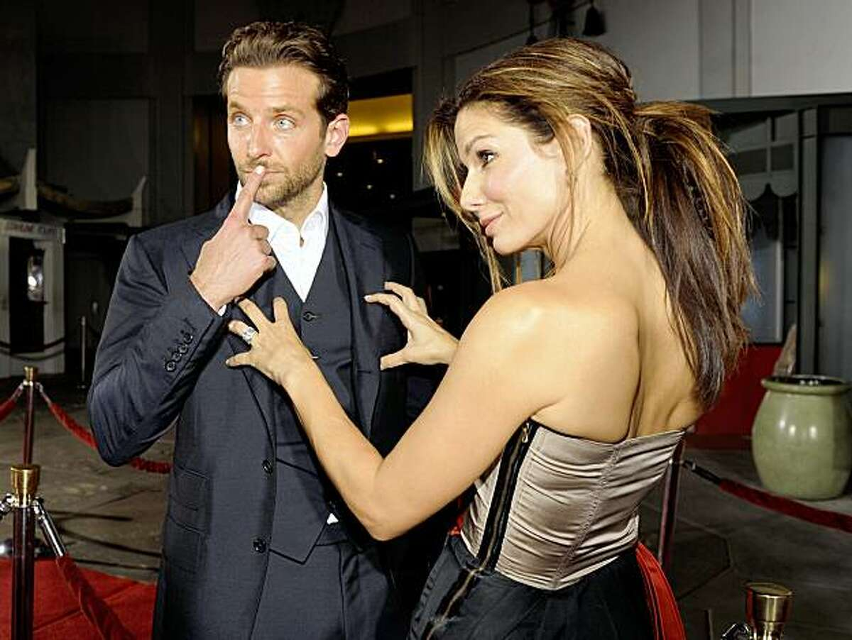 Bradley Cooper, left, and Sandra Bullock, fellow cast members in