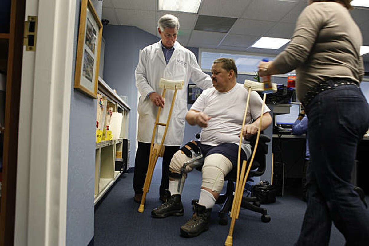 Dr. Kevin Stone (l to r) talks with client Marlin Rudolph of Edmonton, Alberta, Canada as Rudolph heads back to physical therapy at The Stone Clinic on Monday, December 13, 2010 in San Francisco, Calif.