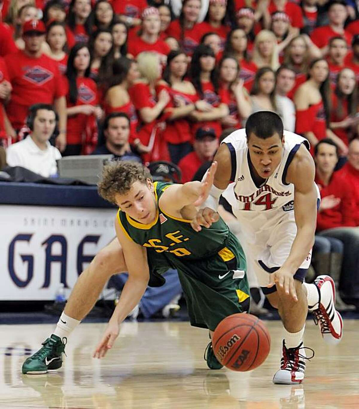 St. Mary's Stephen Holt, right, and USF's Marko Petrovic go after a loose ball in the first half. The St. Mary's College Gaels played the University of San Francisco Dons at McKeon Pavilion at St. Mary's College in Moraga, Calif., on Thursday, January 13, 2011. The Gaels defeated the Dons 71-57.