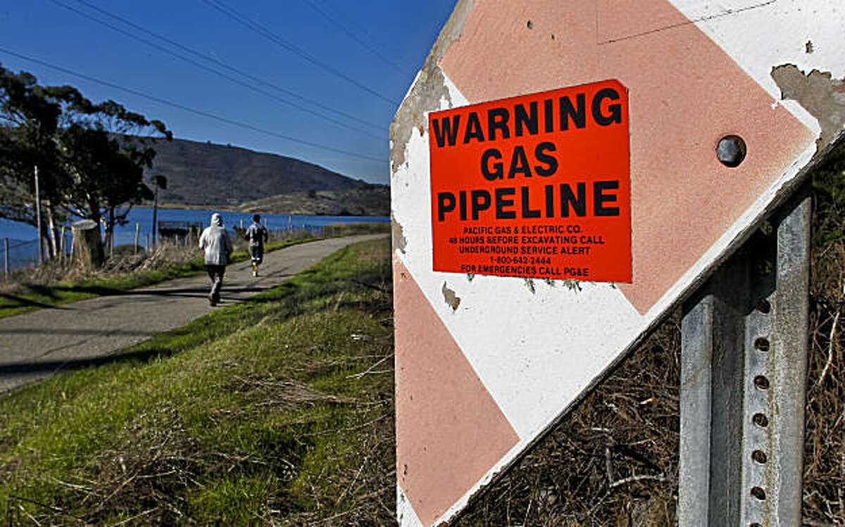 """A gas pipeline, near Crystal Springs Reservoir, runs along the pedestrian pathway at Skyline Blvd. in San Bruno, Ca., Wednesday Jan. 5, 2011, about 1.5 miles south from September's gas pipeline explosion. The federal agency in charge of overseeing gas pipeline safety tells operators nationwide to """"strongly consider"""" reducing pressure on their lines if they aren't confident that their records acccurately reflect the condition of the pipes."""