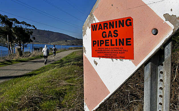 "A gas pipeline, near Crystal Springs Reservoir, runs along the pedestrian pathway at Skyline Blvd. in San Bruno, Ca., Wednesday Jan. 5, 2011, about 1.5 miles south from September's gas pipeline explosion. The federal agency in charge of overseeing gas pipeline safety tells operators nationwide to ""strongly consider"" reducing pressure on their lines if they aren't confident that their records acccurately reflect the condition of the pipes. Photo: Michael Macor, The Chronicle"