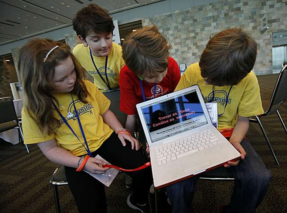 The young animators, left to right: Candise Massa, Nicholas Desroches, Harry Thoemmes, and Trevor Higgins played with a computer with their film on it. Kid animators from Camp Edmo, a techie summer camp, had two short films chosen to be shown at MacWorld Thursday January 27, 2011.