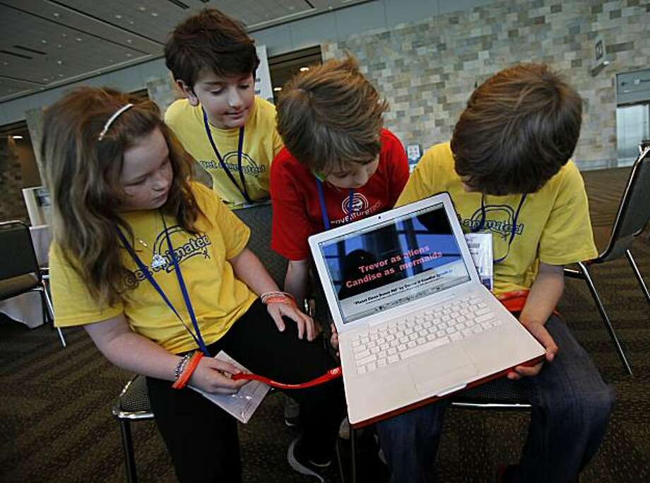 The young animators, left to right: Candise Massa, Nicholas Desroches, Harry Thoemmes, and Trevor Higgins played with a computer with their film on it. Kid animators from Camp Edmo, a techie summer camp, had two short films chosen to be shown at MacWorld Thursday January 27, 2011. Photo: Brant Ward, The Chronicle