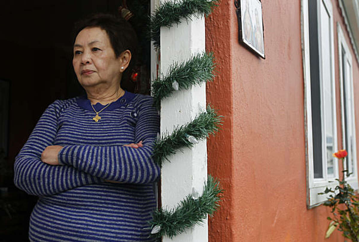 Herminia Morales stands in the doorway of her home in South San Francisco, Calif., on Tuesday, Jan. 11, 2011. Morales is included in a class action lawsuit against her lender after the bank started foreclosure proceedings.