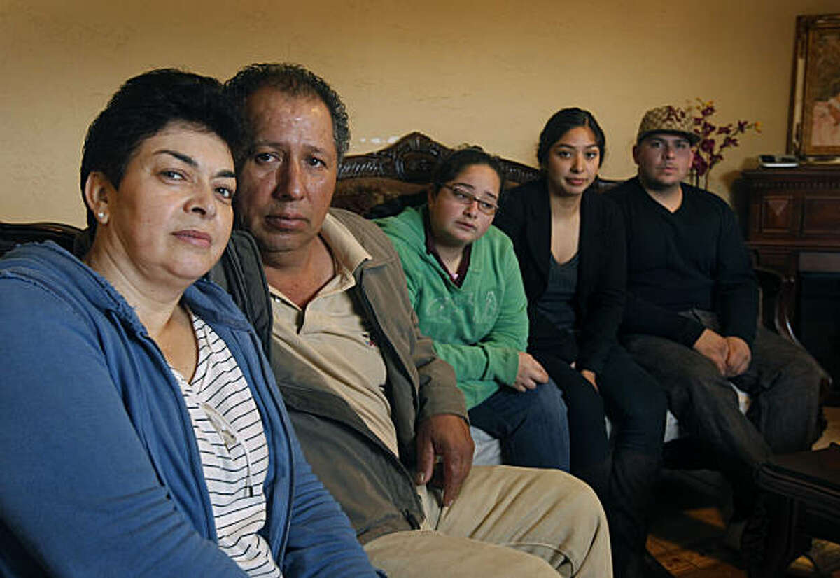 Gustavo Reyes Guerrero and his wife Maria Teresa (left) sit with their children Diana, Maritere and Gustavo Jr. in the living room of their home in Hayward, Calif., on Tuesday, Jan. 11, 2011. The family is suing their mortgage lender after the bank has started foreclosure proceedings.